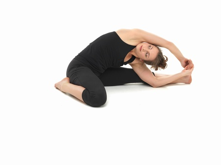 centering: difficult advanced yoga pose by attractive female, on white background, viewed from the front