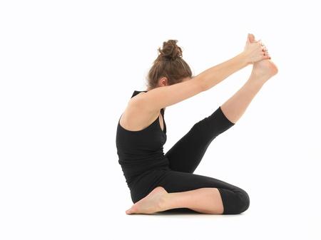 elasticidad: mujer, blanco, vestido de negro, que realiza yoga difícil postura, vista del cuerpo, sobre fondo blanco