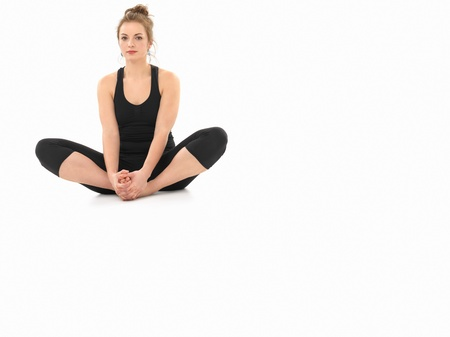 centering: young woman demonstrating yoga pose, full front view, dressed in black, on white background