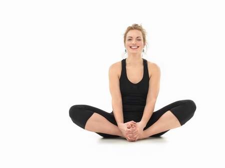 young girl laughing, in yoga pose, full frontal view, black costume, on white background photo