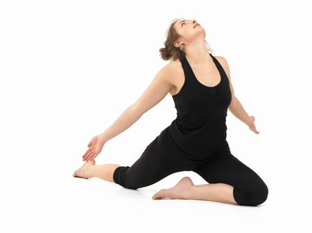 introversion: young slim girl in difficult yoga pose, full frontal view, dressed in black, on white background