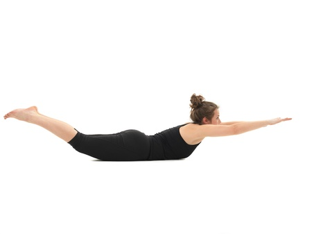young girl in lying yoga pose, side view, full photo