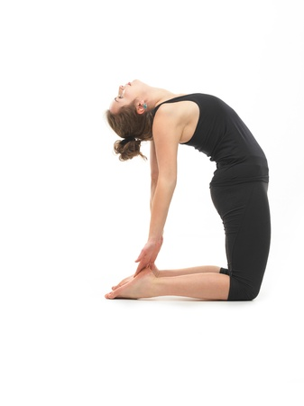 reversed: young attractive woman in back reversed yoga pose, side view, dressed in black on white background