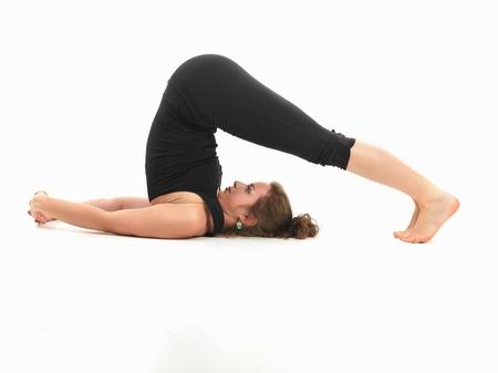 elasticidad: mujer hermosa joven en postura de yoga invertida Foto de archivo