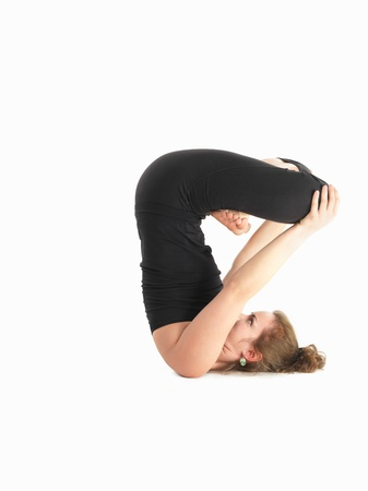 introversion: young caucasian woman in reversed difficult and balanced yoga pose