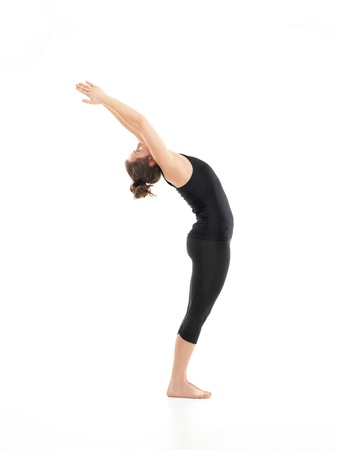introversion: back bent yoga pose, demonstrated by young woman, dreesed in black, on white background