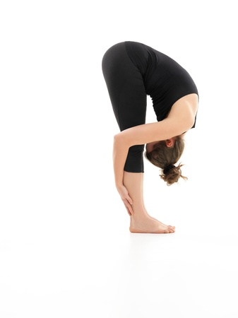 introversion: young womand in intermediate yoga pose, face invisible, full body view Stock Photo