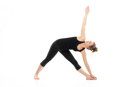 advanced yoga posture, demonstrated by bloden girl, dressed in black, on white background photo