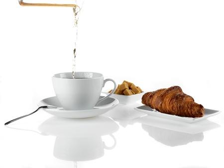 porcelain tea spoon sugar croissant photo