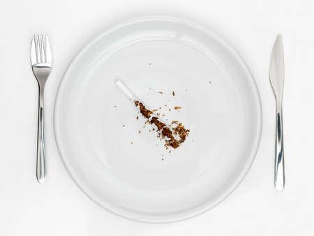 plate with knife and fork and cigarette photo