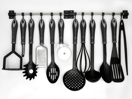 ladles: kitchen utensils hanging white background