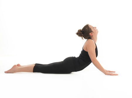 young woman demonstrating difficult yoga posture, full body side view, dressed in black, on white background Stock Photo - 16546574