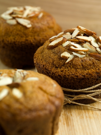almond muffins, on top of a wooden cooking board photo