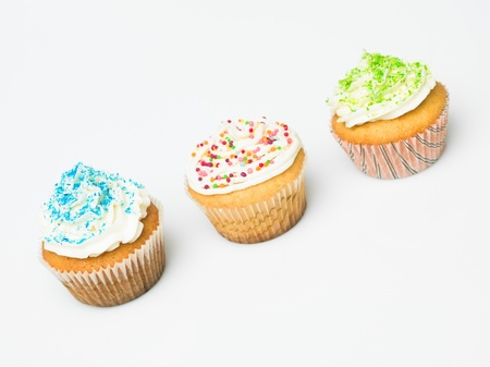 group of multicolored ornate details muffins white background photo