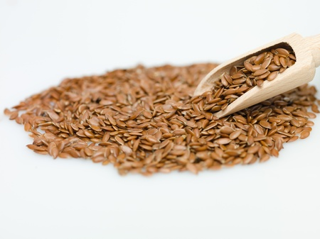 constituent: flaxseed on white background macro detail