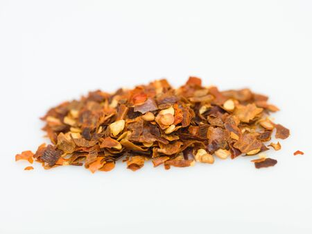 pepper flakes: dry pepper on white background
