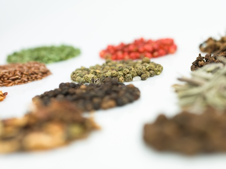 composite image: round spices on white background macro close-up detail colorful Stock Photo