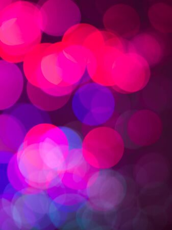 colorful abstract wallpaper with round shaped pink magenta and blue defocused lights photo
