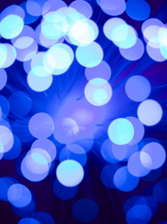closeup of a fiber optic light wand with round shaped blue and white light spots Stock Photo - 16775352