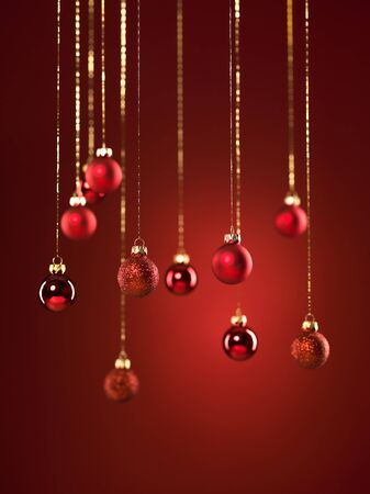 red glittery: closeup of hanging red glittery christmas globes on red background