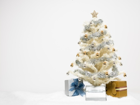White christmas tree beautifully decorated with shiny golden.. stock
