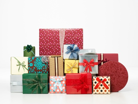 fancy box: a heap of colorful gift boxes with glitter and beautiful decorations isolated on white background
