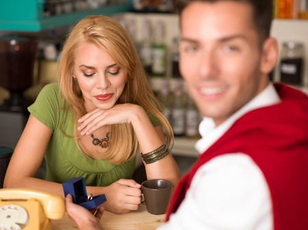 close-up of young beautiful caucasian girl being overwhelmed by a marriage proposal in a cafe Stock Photo - 17752990