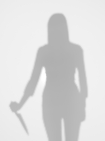 female silhouette holding a knife in her hand behind a diffuse surface photo