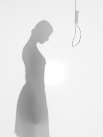 sentence: female body silhouette standing in front of a hanging rope committing suicide, behind a diffuse surface