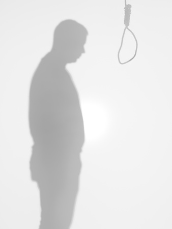suffocate: male body silhouette standing in front of a hanging rope committing suicide, behind a diffuse surface