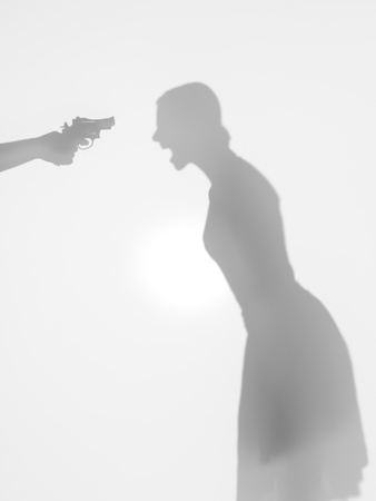 threatened: woman body silhouette standing and screaming, beeing thretened with a gun, behind a diffuse surface
