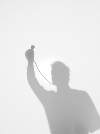 cardiologist: front view of man holding up a stethoscope listening and looking for something, behind a diffuse surface