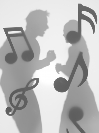 side view of man and woman dancing face to face, surrounded with musical notes, behind a diffuse surface photo