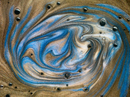 macro of brown and blue pigment mixed with oil with black spots on top of the surface Stock Photo - 18555327