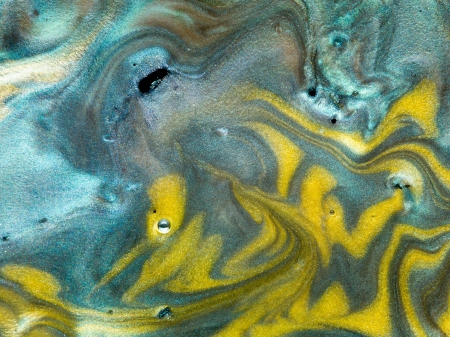 macro of different colored pearlescent pigments mixed with oil Stock Photo - 18555323
