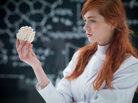 psilocybin: close-up of a student analyzing mushrooms in a chemisty lab with a blackboard on the background