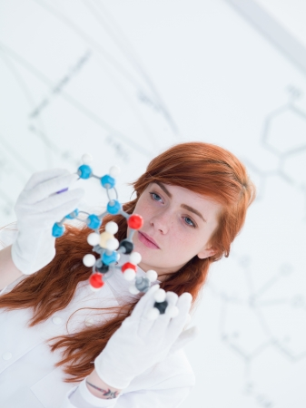 close-up of a student in a chemistry lab analyzing DMT molecular model photo