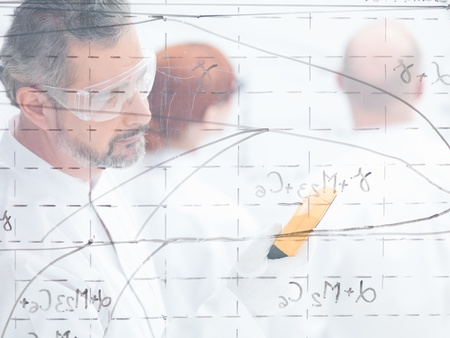 blurred close-up of a man in a laboratory scanning in front of a transparent board photo
