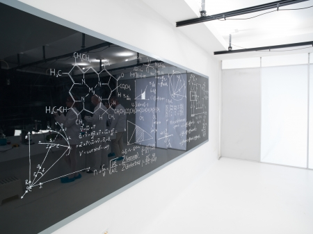 analytical: side view of a blackboard with formulas in a chemistry lab Stock Photo