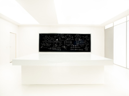 worktable: general-view  of a chemistry laboratory with a worktable and blackboard with formulas on it on the background Stock Photo