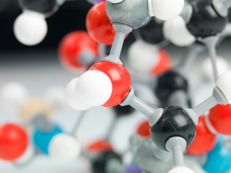 three dimensional representation molecular structure composed of multi colored spheres with grey bonds photo