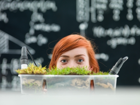 sprouting: Conceptual photograph of a female medical science student in the laboratory. Stock Photo