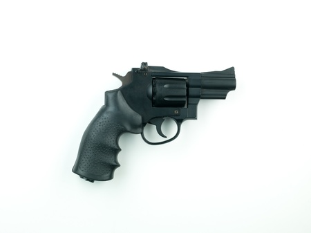 A black revolver isolated on a white background photo