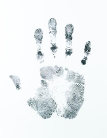 delincuencia: imagen de una huella de la palma derecha en una hoja blanca