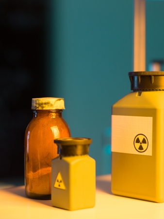 hazardous: close-up of toxic waste containers placed on a shelf in a laboratory Stock Photo