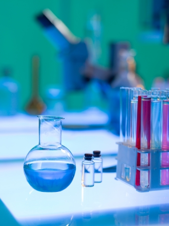 compound: close-up of chemistry laboratory tubes filled with colorful fluids placed on a table Stock Photo