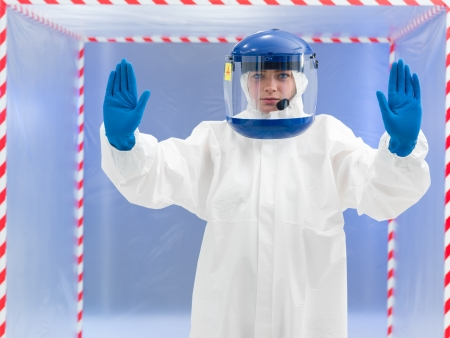 toxicity: person in protective suit and helmet calling a halt with both arms