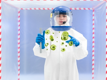 unsanitary: person in protective suit holding microorganism samples on a glass slide and pointing to one of them in front of a containment tent