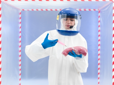 unsanitary: person in biohazard suit calling holding a chunk of raw meat with one hand and with the other injecting it with a syringe in front of a containment tent