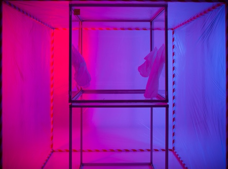 containment: sterile chamber in a containment tent with a purple and blue background